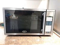 stainless steel and black Oster microwave oven Gaithersburg, 20879