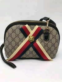 brown and black Gucci leather crossbody bag Lithonia, 30038