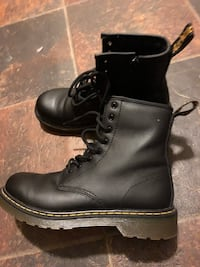 pair of black Dr. Martens 1460 boots 31 mi