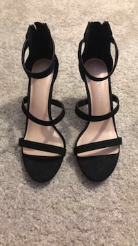 pair of black-and-brown open-toe suede pumps