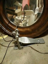 grey drum pedal and brown wooden frame wall mirror