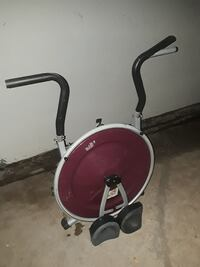 red and white AB exercise machine