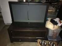 black wooden TV stand with flat screen television Highland