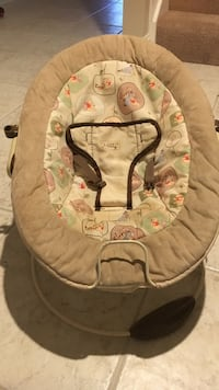baby's white and brown bouncer
