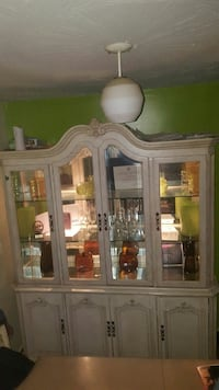 white wooden china cabinet