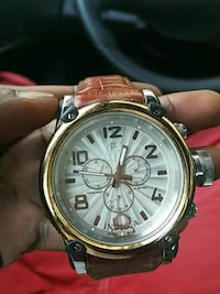 round silver-colored chronograph watch with brown