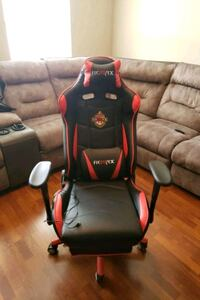 Gaming chair with vibrating back support