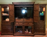 Flat screen television with brown wooden tv hutch Centerville, 45429