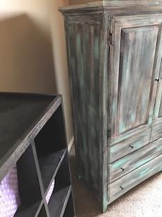 gray and teal wooden armoire