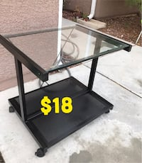 """Glass & metal rolling side table 22"""" H x 24"""" W. Firm on price"""
