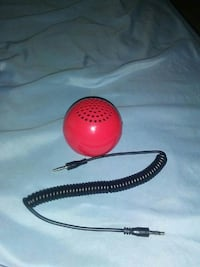 round portable speaker with cable