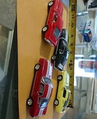 four diecast toy cars