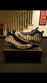 pair of brown Nike Foamposite Pro shoes