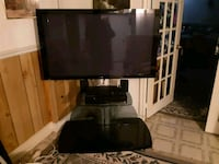 black flat screen TV with remote. Toronto, M1B 3A5