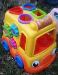 yellow, orange, blue, and green shape sorter car toy