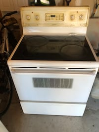 White and black induction range oven Mississauga, L5T 1B7