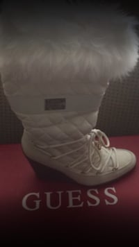unpaired white Guess wedge boot