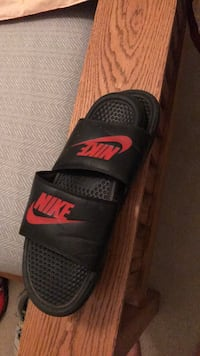 black-and-red Nike slide sandals
