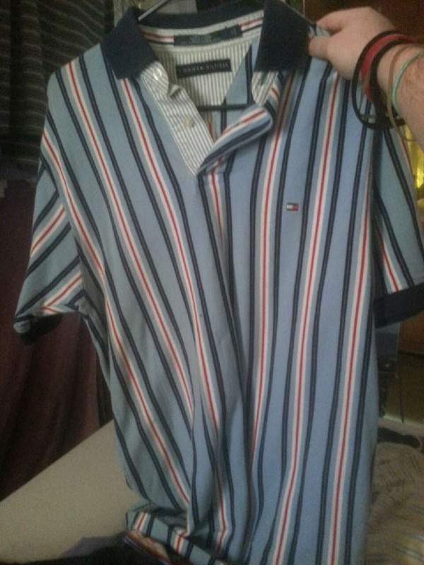 b8814e0b Used blue, black, and white stripe tommy hilfiger polo shirt for sale in  Eden - letgo