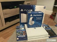 black and gray Sony PS4 console with controller Long Beach