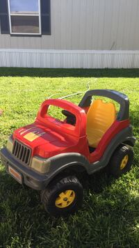 Toddler's red, gray and yellow plastic ride on toy Garden City, 67846