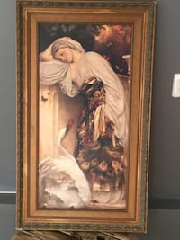 woman in white dress painting with brown wooden frame