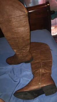 pair of brown leather round-toe chunky heeled knee-high boots