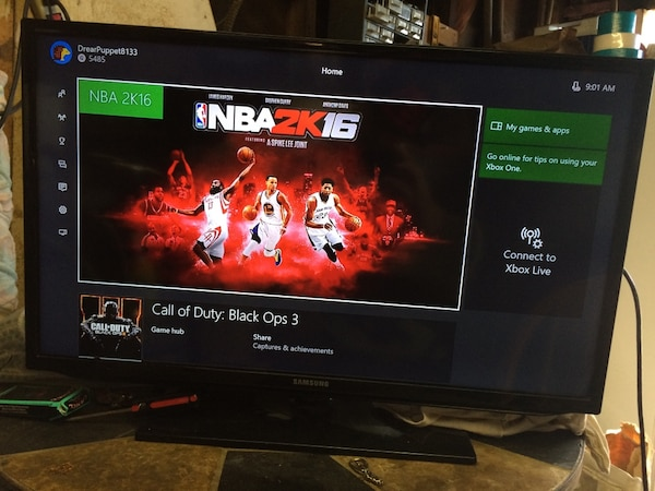 Black samsung flat screen tv and Xbox 1 with games and controller