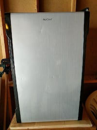 white and black NuCool single door refrigerator