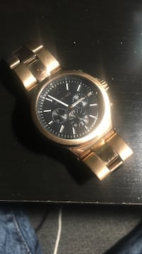 Michael Kors rose gold watch. needs a new battery