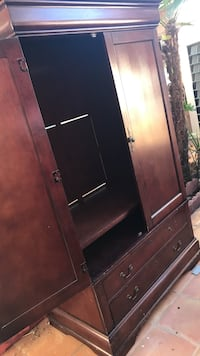 brown wooden armoire