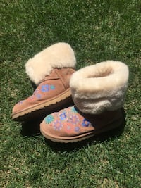 Brown and white fur boots