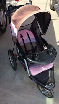 Baby's purple and black jogging stroller