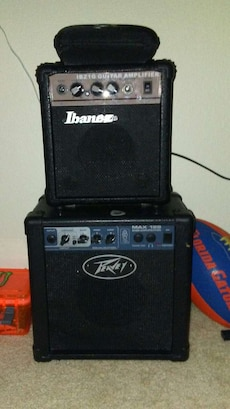 two black Ibanez and Peavey guitar amplifiers