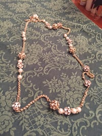 Long gold necklace with pearls and rhinestone clusters
