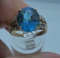 10KT YELLOW GOLD FASHION RING WITH DIAMONDS AND BLUE STONE 3.9GR SIZE  [TL_HIDDEN] . Baltimore, 21205