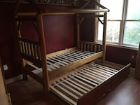 Brown wooden trundle bed