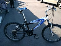 blue and white Mongoose full-suspension mountain b Queens, 11374