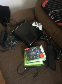 black Xbox 360 console with controller and game cases Toronto, M4T 1S2