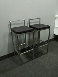 Metal and leather bar stool height chairs. Hamilton, L9B 1B9