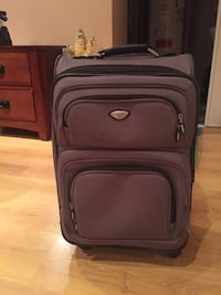black and gray luggage bag Laval, H7X 4G4