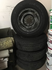Black 8-lug vehicle wheel and tire set. Commercial, Very low mileage, almost new. Longueuil, J3Y 3M7