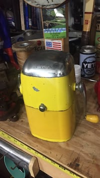 yellow and gray metal manual grinder machine 1300 mi
