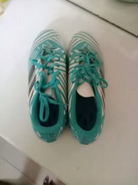 pair of green-and-white Nike cleats Surat, 395004