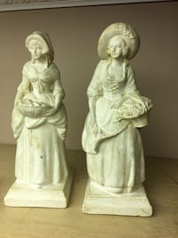 two woman in white dress figurines