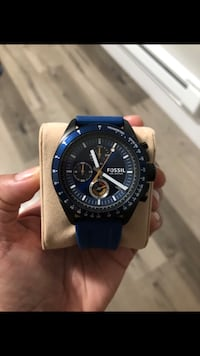 round black chronograph watch with blue strap Vancouver, V5T 2H9