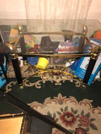 Glass dinning room table comes with 3 chairs I'm moving so I'm selling it no cracks or anything thanks  31 km