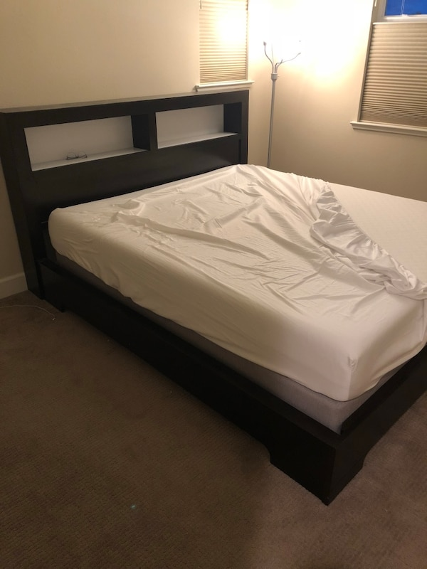 Used California king size bed frame (include mattress boxes) for