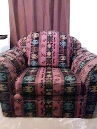 pink and green floral fabric sofa chair