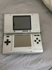 White nintendo ds with game cartridge St Catharines, L2R